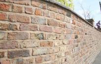 Wall build from reclaimed bricks